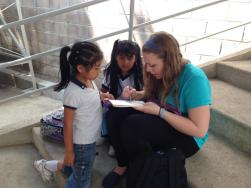 Coloring with a couple girls at the CDI during some free time. A few of the children would hang out around the center after the others went home because they lived nearby or their mothers were helping out to clean or cook in the center.