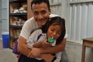 Pastor Victor having fun with Margarita at the CDI.