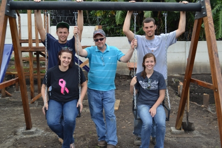 The Shonkwiler family on the brand new set of swings on the playground.