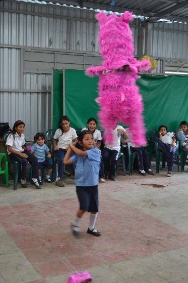 Clara taking her turn at the piñata during the party at the CDI.
