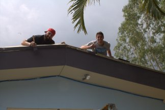 Josh and Tyler painting on the roof at the San Salvador church.