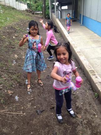 Some of the girls playing with some bubbles donated to the CDI by a missions team!